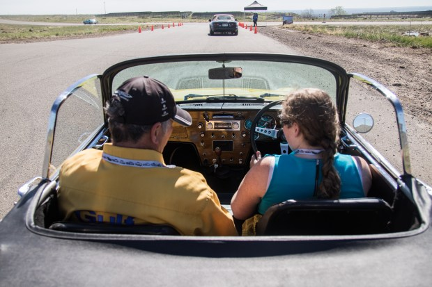 Owner William Taylor lets Kimber Burns, a 24-year-old from Castle Rock, drive his 1966 Lotus Elan. The training session to teach millennials the joy of manual transmission cars was part of the Hagerty Driving Experience, held in Golden on May 13, 2017.