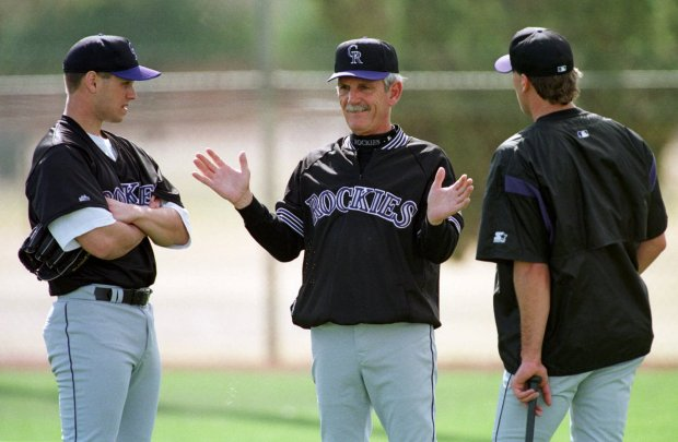 Colorado Rockies manager Jim Leyland, center, discusses technique with pitchers Jamie Wright, left, and Mike DeJean, Sunday, Feb. 21, 1999, in Tucson, Ariz. (AP Photo/Robert F. Bukaty)