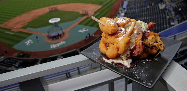 The Pulled Pork Patty Melt is seen at Kauffman Stadium before a baseball game between the Kansas City Royals and the Chicago White Sox on Tuesday, May 2, 2017, in Kansas City, Mo. The sandwich features pulled pork with cheese, bacon and cole slaw between a funnel cake bun and is topped with a jalapeno. (AP Photo/Charlie Riedel)