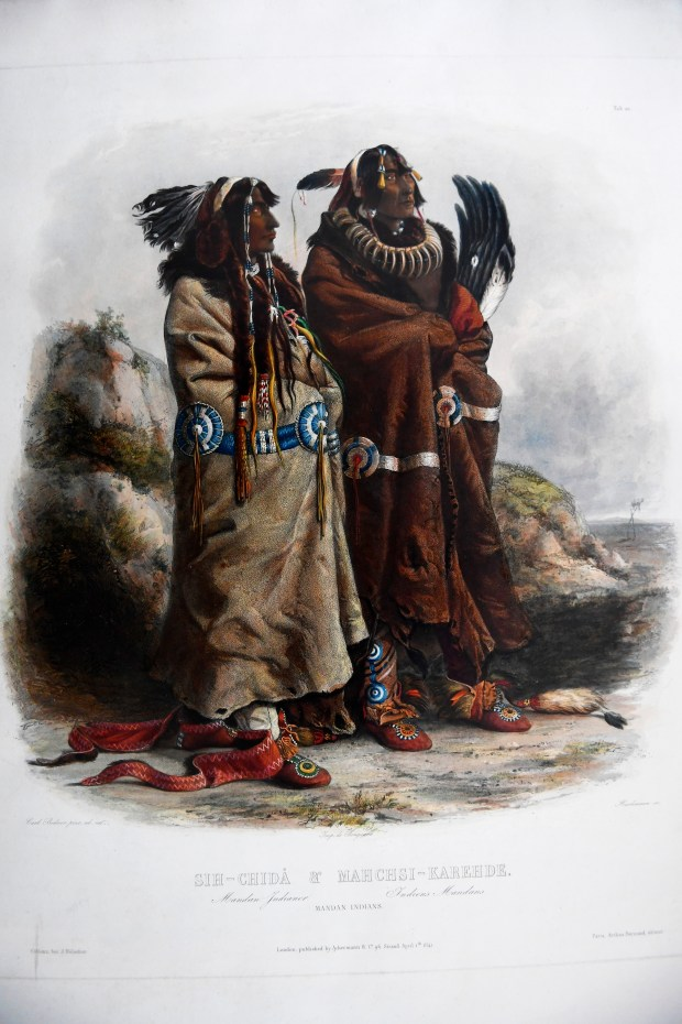 DENVER, CO - MAY 22: Tam O'Neill is retiring and her Cherry Creek print gallery Tam O'Neill Fine Arts will be closing. Sih-Chida and Mahchsi-Karehde, Mandan Indians, Engraving of a watercolor painting by Karl Bodmer (1809-1893) from a 1832-1834 series portraying American Indians, Indian life, ceremonial objects, and Western scenery. May 22, 2017 in Denver, Colorado. (Photo by Joe Amon/The Denver Post)