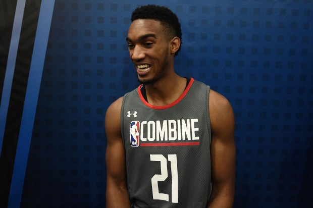Terrance Ferguson #21 speaks to reporters ...