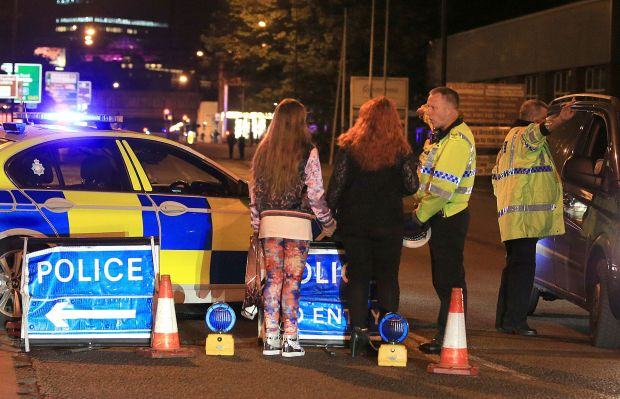Police respond to Monday night's bombing at Manchester Arena in Manchester England, where a suicide bomber killed 22 people after an Ariana Grande concert.