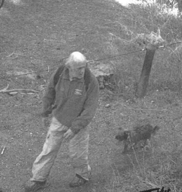 The man seen in these video images is a person of interest. He was caught on camera at 8 a.m. on May 14 stealing a laminated paper sign being used as a replacement for one of the stolen signs.