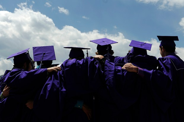 Arvada West High School students pose for photos before graduation on May 22, 2013 in Boulder.