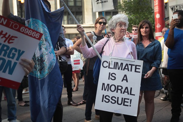 Demonstrators protest President Donald Trump's decision to exit the Paris climate change accord on June 2 in Chicago.