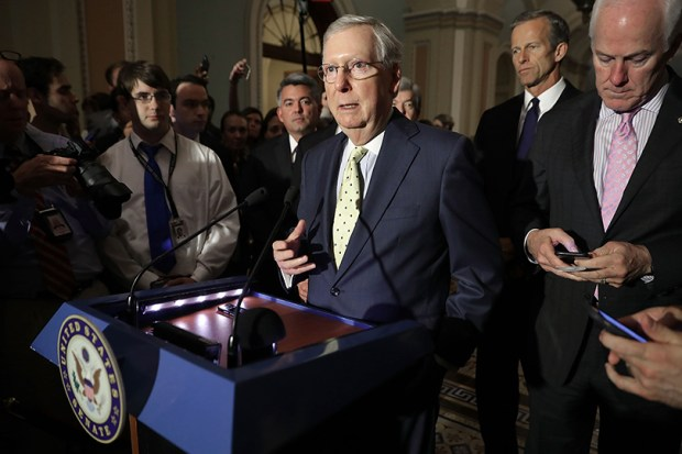 U.S. Senate Majority Leader Mitch McConnell, along with several Republican senators, speaks to reporters Tuesday after the weekly GOP policy luncheon at the U.S. Capitol.