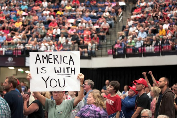 Supporters of President Donald Trump attend a rally in Cedar Rapids, Iowa, on Wednesday. Trump spoke about renegotiating NAFTA and building a border wall that would produce solar power.