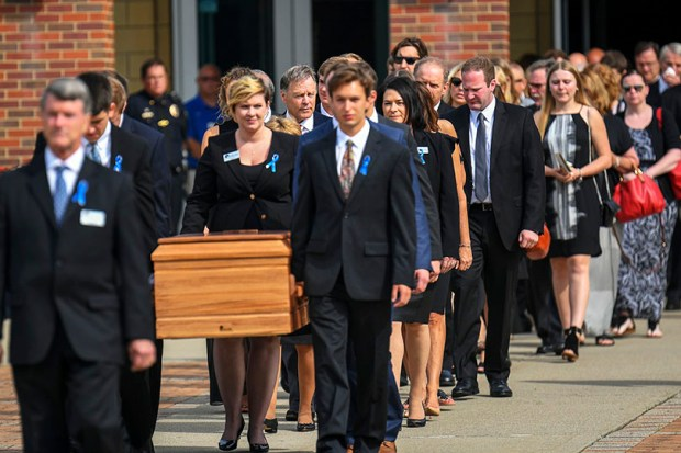 The casket of Otto Warmbier is carried after his funeral in Wyoming, Ohio, on Thursday. Warmbier, a University of Virginia graduate student, was released from a North Korean prison last week after 17 months in captivity. He was in a coma when he was sent back to the U.S., and died on Monday.