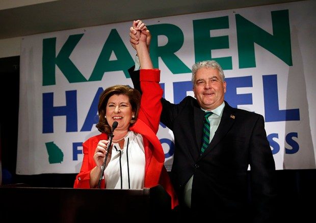 Republican candidate for Georgia's 6th District Congressional seat Karen Handel celebrates with her husband Steve as she declares victory during an election-night watch party Tuesday in Atlanta.