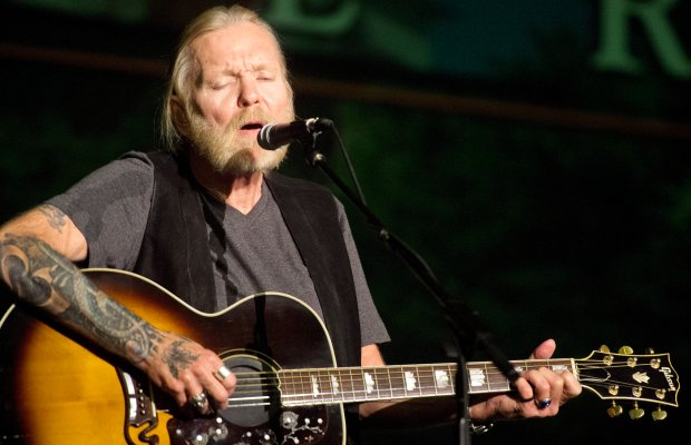 In this May 16, 2016 photo, Rock and Roll Hall of Famer Gregg Allman performs during Mercer University's Commencement Saturday at Hawkins Arena in Macon, Ga. Allman received an honorary Doctor of Humanities degree.