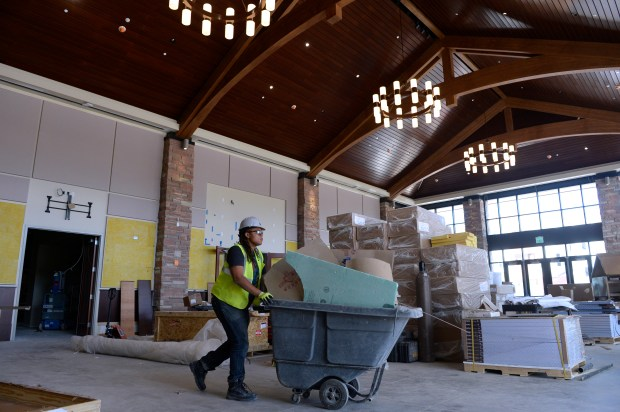 Construction crews continue work inside the ...