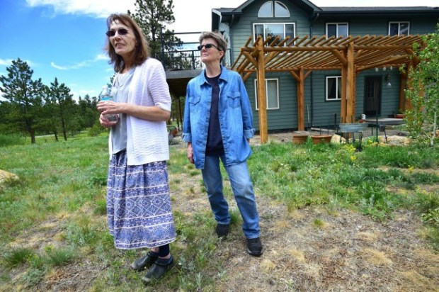 Linda Lund, left, and Irene Rickertt, stand outside their home Friday west of Jamestown.