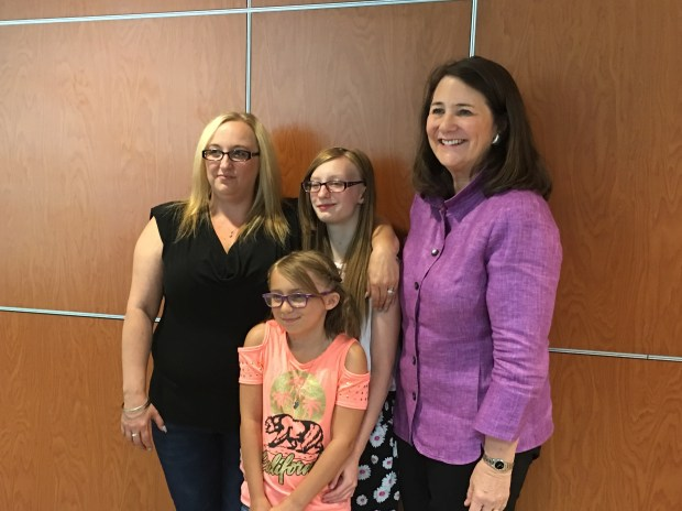 U.S. Rep. Diana DeGette, right, poses with Tasha Snyder, middle back, and her mother, Stephanie Eckenrode, on Monday at Rocky Mountain Hospital for Children.