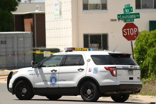 Crime tape cordons off the scene of an officer-involved shooting by an ICE agent in Denver on Friday, June 9, 2017.
