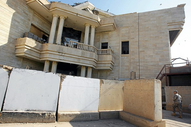 A U.S. soldier walks into a palace owned by former Iraqi leader Saddam Hussein where he was detained after his capture and prior to his Dec. 30, 2006, hanging.