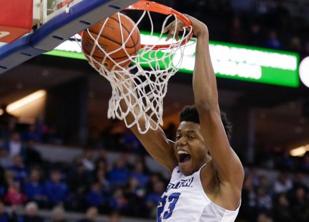 Creighton's Justin Patton (23) dunks during ...