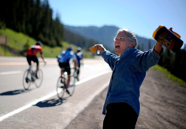 Karen Aviles of Denver cheers cyclists at Wolf Creek Pass on June 18, 2010.