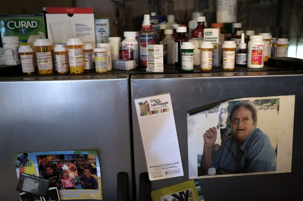 Medications cover the refrigerator in the home of Kathy Strait in Pemiscot County, Mo.