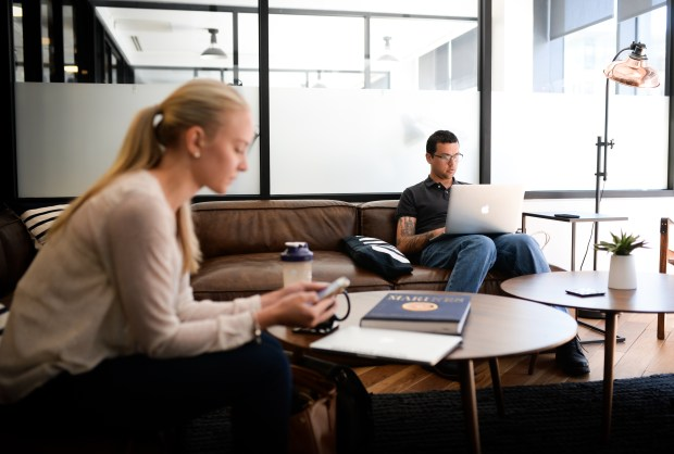 Kerrie Gill and Rick Rein utilize the office space at WeWork in Denver on June 7, 2017.