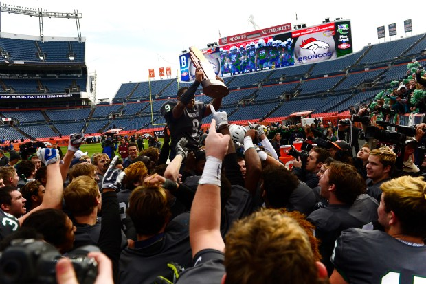 Pine Creek running back David Moore III celebrates with his teammates after winning the 2016 Class 4A state title at Sports Authority Field.