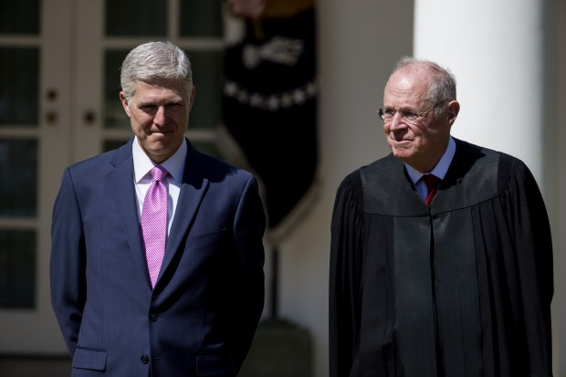 U.S. Supreme Court Associate Justices Neil Gorsuch, left, and Anthony Kennedy are seen during a ceremony in the Rose Garden at the White House on April 10. Kennedy, who turns 81 on Sunday, is reportedly considering retiring next year.
