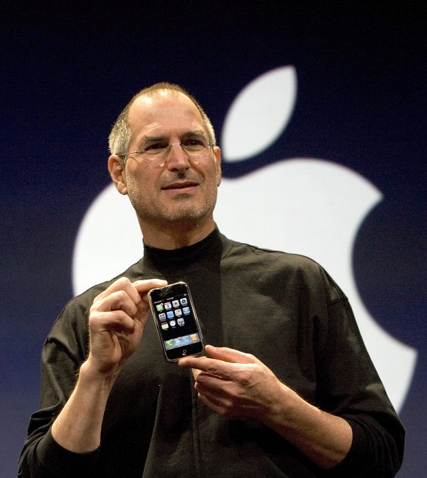 Apple CEO Steve Jobs holds up ...