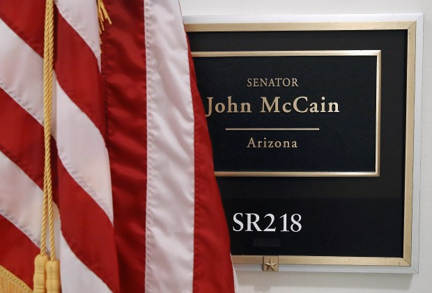 Sen. John McCain's name plaque hangs at the entrance to his office inside of the Russell Senate Office Building on Thursday. It was announced this week that the longtime senator from Arizona was diagnosed with brain cancer.