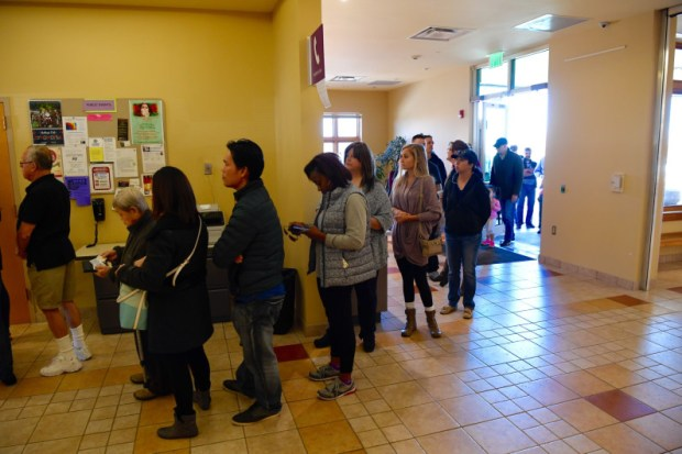 Voters wait in line at the Smoky Hill Library in Aurora on Nov. 8, 2016.