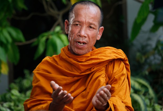 "In this April 28, 2017 photo, former enslaved fisherman, now a Buddhist monk Prasert Jakkawaro speaks during an interview with The Associated Press journalists in Samut Sakhon, Thailand. Siwaourai turned to religion and became a Buddhist monk since his return. ""I feel that I have to give forgiveness and kindness back"" he said. ""I have another chance. There's no point in dwelling on the past and the anger will only carry with me in this life and into the next."""