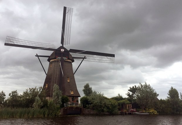 One of the Kinderdijk windmills in Kinderdijk, Netherlands. The windmills are still used to pump water from low-lying lands in western Netherlands and have become one of the country's most popular tourist destinations.