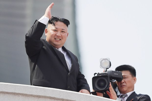 In this April 15, 2017, file photo, North Korean leader Kim Jong Un waves during a military parade in Pyongyang, North Korea. For nearly 70 years, the three generations of the Kim family have run North Korea with an absolute rule that tolerates no dissent. The ruling family has devoted much of the country's scarce resources to its military but has constantly feared Washington is intent on destroying the authoritarian government. (AP Photo/Wong Maye-E, File)