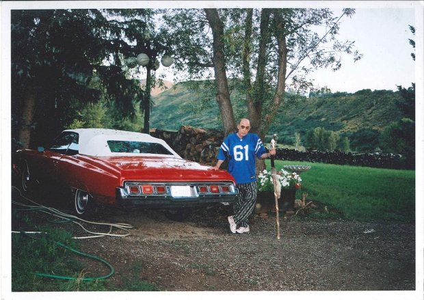 Hunter S. Thompson poses by his car in this undated photo taken at Owl Farm in Woody Creek, just outside Aspen in the Roaring Fork Valley.