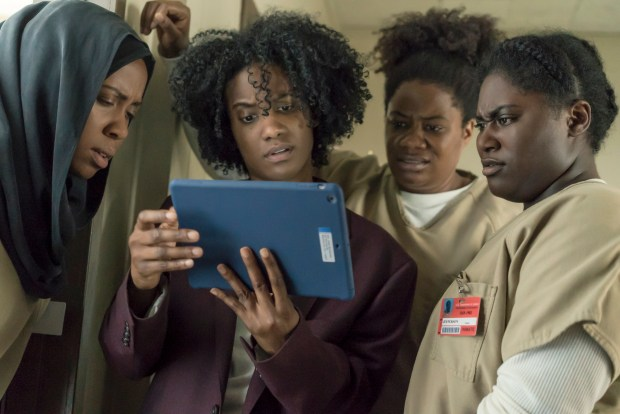 "From left, Amanda Stephen, Vicky Jeudy, Adrienne C. Moore and Danielle Brooks appear in the Netflix series ""Orange Is the New Black."""