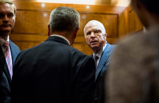 Sen. John McCain, R-Ariz., speaks to journalists during an all night session to consider the Republican healthcare bill on Capitol Hill in Washington on July 27, 2017.
