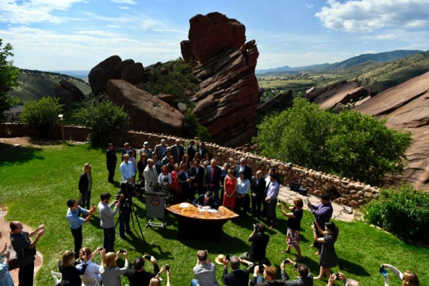 Gov. John Hickenlooper signs an executive order at Red Rocks Park on Tuesday, committing the state to reducing greenhouse gases by more than 26 percent by 2025, reduce carbon dioxide emissions from the electricity sector by 25 percent by 2025, and 35 percent by 2035.