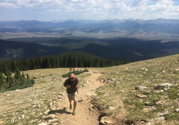 GOLDEN, CO - JULY 30: Patrick Richardson looks at the view as he climbs just above tree line at about 12,000 feet on his way to the top of Mt. Elbert, Colorado's highest 14'er on July 30, 2016. Mt. Elbert is the highest point in Colorado and the second highest mountain in the lower 48 states. Mt. Elbert tops out at 14,400 feet only 12 feet taller than Mt. Massive, it's neighbor to the north. Mt. Elbert tops out at 14,400 feet only 12 feet taller than Mt. Massive, it's neighbor to the north. On the North Elbert trail, one of the more popular routes to the summit, the trail is 9 miles round trip and the elevation gain is 4,700 feet. (Photo by Helen H. Richardson/The Denver Post)