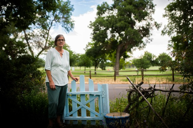 DENVER, CO - JULY 21: Helene Orr lives across the street from the public Overland Park golf course and opposes the upcoming music festival that is expected to bring in tens of thousands of listeners next summer. She is worried not only about her home, but about the plentiful vegetation and tree life on the golf course on July 21, 2017 in Denver, Colorado. (Photo by Gabriel Scarlett/The Denver Post)