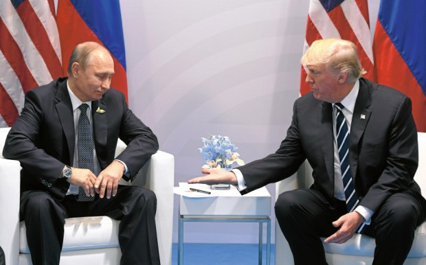 Russian President Vladimir Putin takes his time to shake hands with President Donald Trump during a meeting on the sidelines of the G20 Summit in Hamburg, Germany, on July 7.