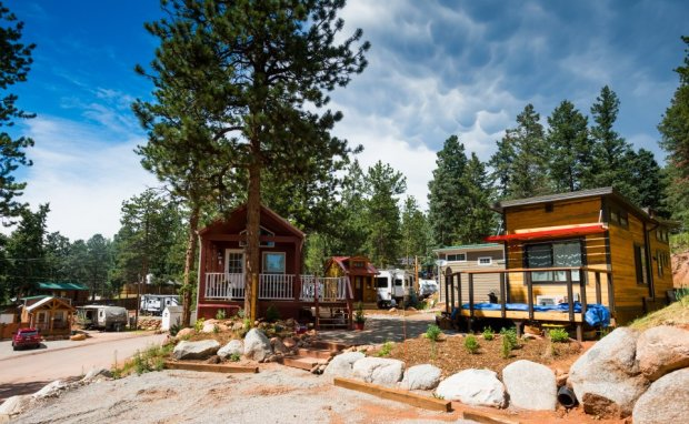 While tiny homes are becoming increasingly popular, zoning regulations and land use development codes in counties across Colorado make placing the structures a challenge. Because the homes are considered recreational vehicles, most jurisdictions in Colorado have rules that prevent them from being used as permanent housing. But, at Peak View Park in Woodland Park, owners of tiny houses are able to circumvent the rules because the former mobile home park outdates the county regulation that stipulates RVs can only be used as temporary housing.