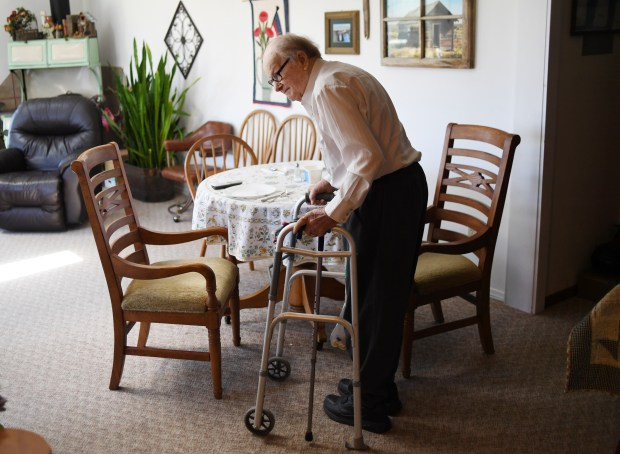 James Gourley, 98, waits for his wife to finish up making supper on July 20, 2017 in Two Buttes, Colorado.