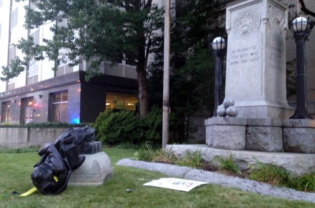 A toppled Confederate statue lies on the ground on Monday in Durham, N.C. Activists used a rope to pull down the monument outside a Durham courthouse.