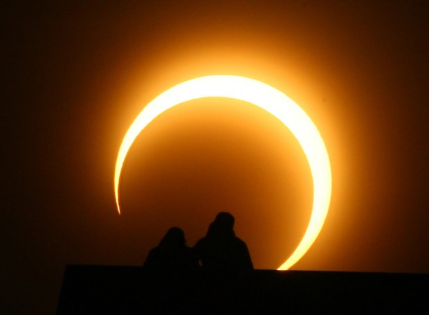 A Chinese couple watches a solar eclipse over Zhengzhou on Jan. 15, 2010.