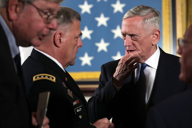 U.S. Secretary of Defense Jim Mattis, right, talks to Chief of Staff of the Army Mark A. Milley prior to a Medal of Honor ceremony at the White House on July 31.