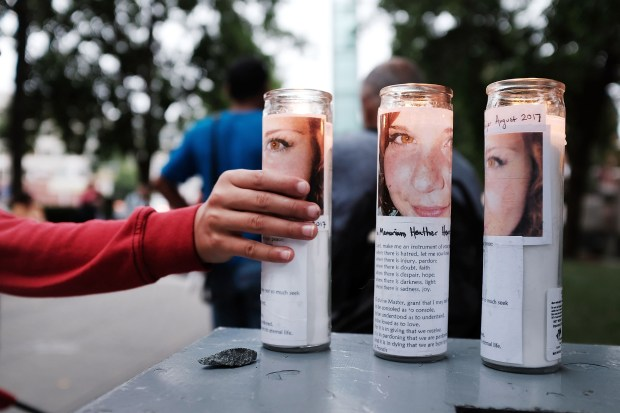 Candles adorned with photos of Heather Heyer are displayed at the New England Holocaust Memorial in Boston on Aug. 18. Heyer was killed when a car rammed into a crowd of counter-protesters at a white nationalist rally in Charlottesville, Va., the previous weekend.
