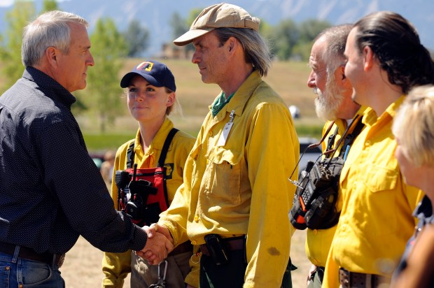 Colorado Gov. Bill Ritter thanks volunteer firefighters who had fought the Fourmile Canyon fire in Boulder in September 2010. Nearly two-thirds of the approximately 30,000 fire departments nationwide are run solely by volunteers.