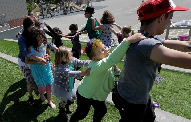 In this Tuesday, July 11, 2017 photo, campers and camp counselors dance at the Bay Area Rainbow Day Camp in El Cerrito, Calif. Organizers say the camp gives kids a safe, fun place to be themselves. The camp's enrollment has tripled since it opened in 2015, and plans are underway to open a branch next summer in Colorado.