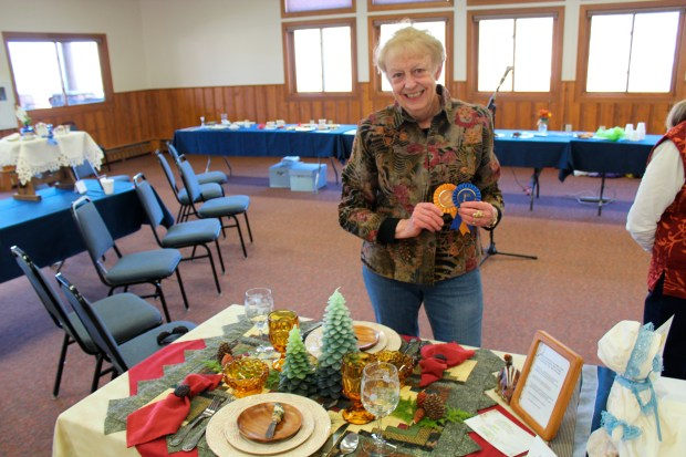 Andrea Smith receiving her First Place and Best in Show awards at the Creative Colorado Table Setting Contest in Estes Park. The event was held at the YMCA of the Rockies as a fundraiser for the Estes Park Museum.