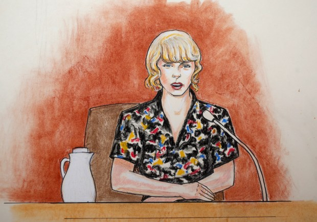 In this courtroom sketch, pop singer ...