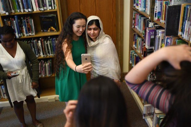 Cherokee Ronolo-Valdez, 17, a senior at Denver South High School takes a selfie with Nobel Peace Prize winner Malala Yousafzai, Oct. 21, 2016.