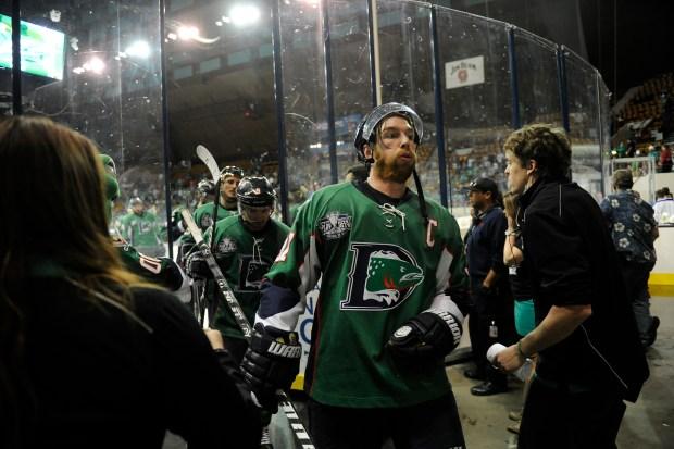 Aaron MacKenzie (37) of the Denver ...